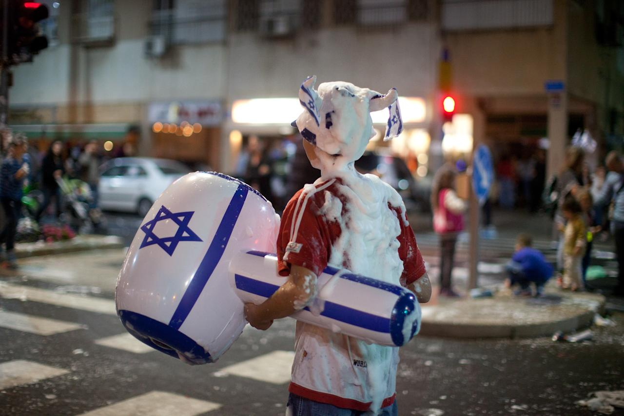 TEL AVIV, ISRAEL - APRIL 15:  (Israel out) An Israeli boy is covered with foam as Israelis celebrate the Jewish state's 65th Independence Day on April 15, 2013 in Tel Aviv, Israel.  (Photo by Uriel Sinai/Getty Images)