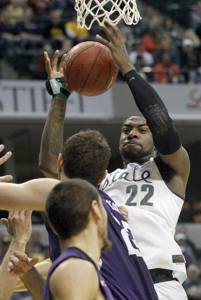 Dawson, No. 22 Spartans top Northwestern 67-51