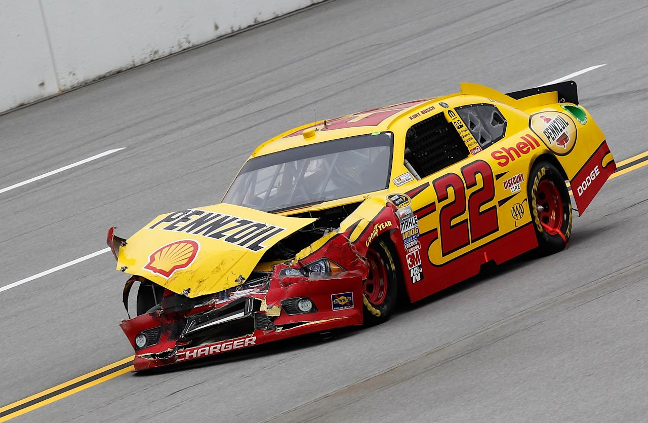 TALLADEGA, AL - OCTOBER 23:  Kurt Busch, driver of the #22 Shell/Pennzoil Dodge, drives with damage to his car during the NASCAR Sprint Cup Series Good Sam Club 500 at Talladega Superspeedway on October 23, 2011 in Talladega, Alabama.  (Photo by Jeff Zelevansky/Getty Images for NASCAR)