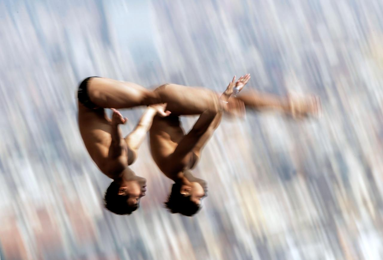 BARCELONA, SPAIN - JULY 21: Yuan Cao and Yanguan Zhang of China competes in the Men's 10m Platform Synchronised Diving preliminary round on day two of the 15th FINA World Championships at Piscina Municipal de Montjuic on July 21, 2013 in Barcelona, Spain. (Photo by Adam Pretty/Getty Images)