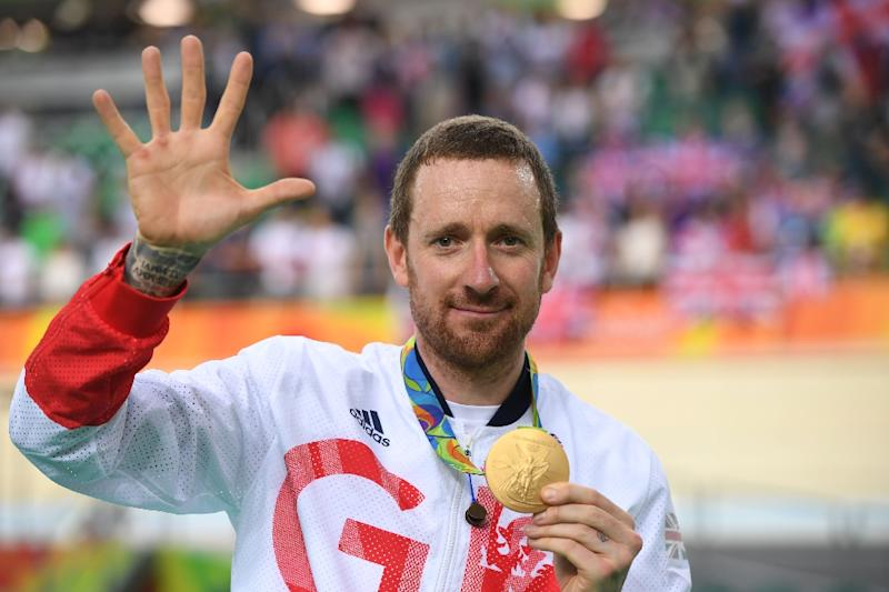 Gold-medallist Bradley Wiggins poses on the podium after the Team Pursuit finals track event during the Rio 2016 Olympic Games on August 12, 2016