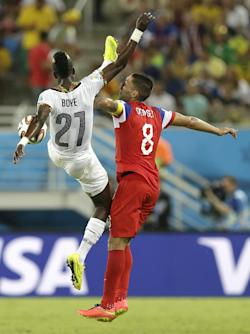Dempsey (right) was kicked in the face by John Boye. (AP)