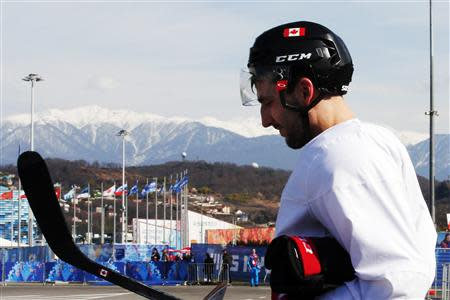 Canada's ice hockey player Patrice Bergeron walks to the Bolshoy arena following a men's team practice at the 2014 Sochi Winter Olympics