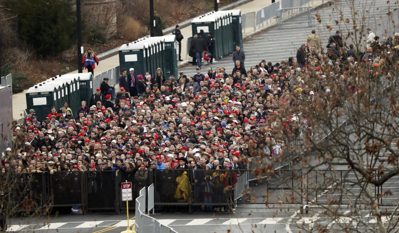 People line up behind security fencing on Capitol grounds for the inauguration to swear in Donald Trump as the 45th president of the United States in Washington, U.S., January 20, 2017. REUTERS/Carlos Barria