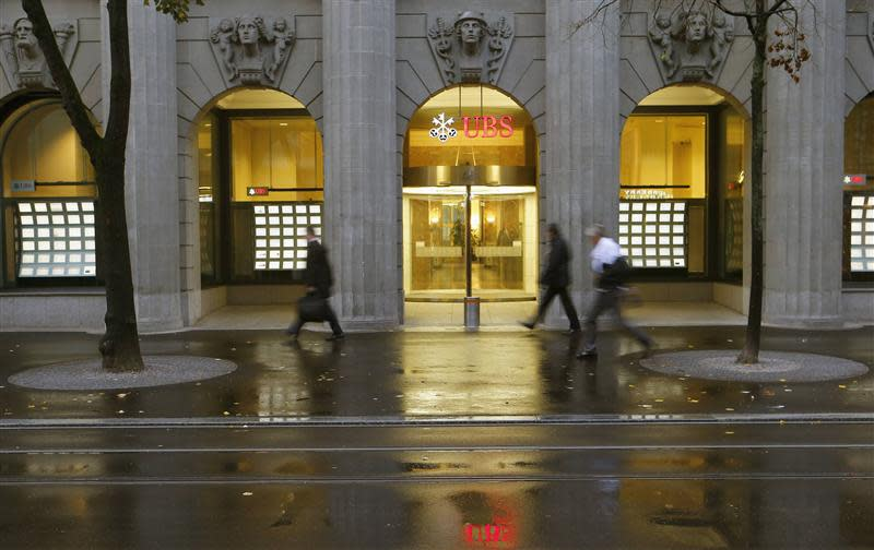 People walk past a branch office of Swiss bank UBS in Zurich