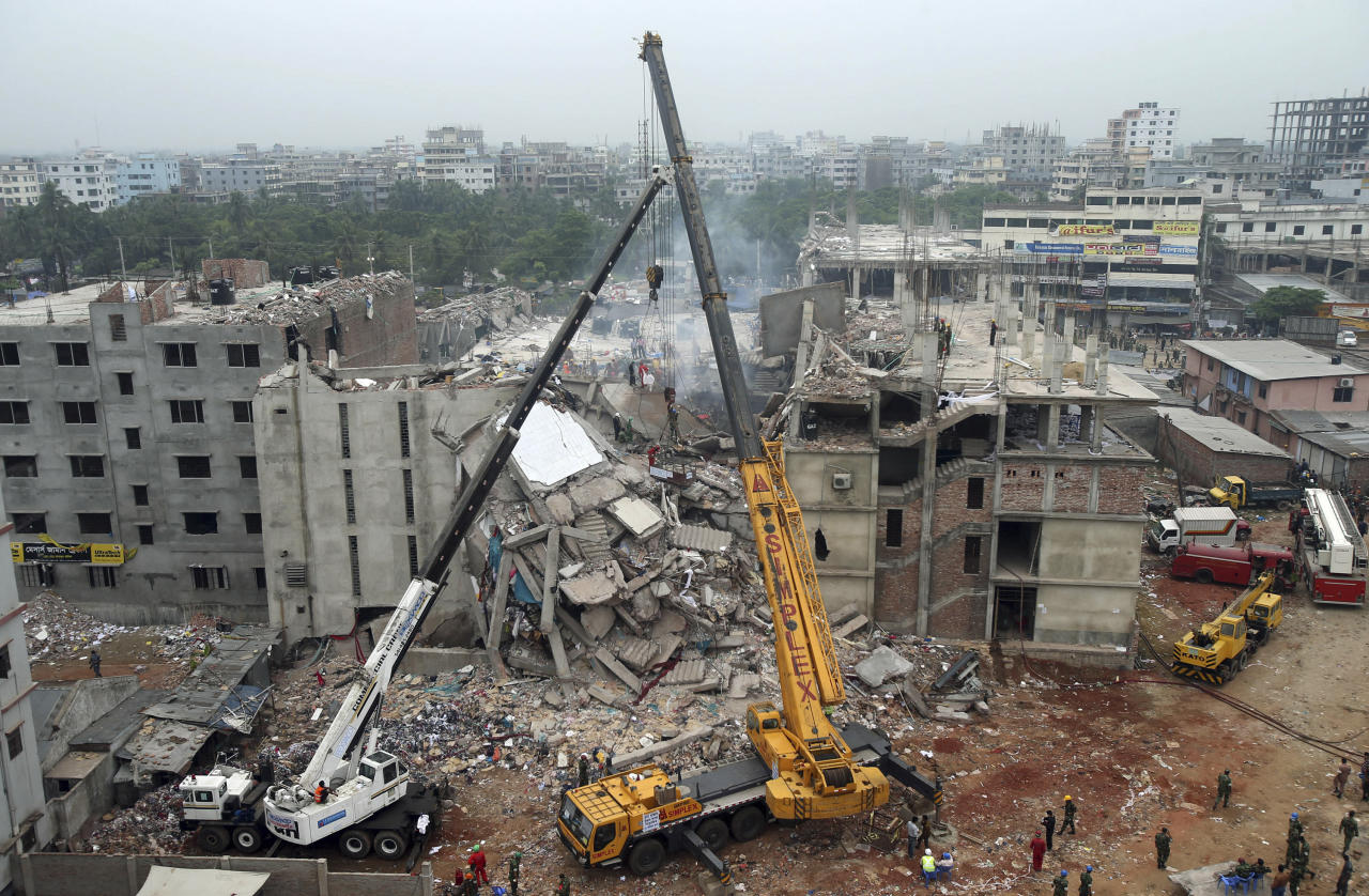 <p> FILE - In this April 29, 2013 file photo, the collapsed Rana Plaza garment factory building is seen from a building nearby as a crane prepares to lift the fallen ceiling in Savar, near Dhaka, Bangladesh. A Bangladeshi garment industry leader on Saturday, April 18, 2015, guardedly welcomed Italian retailer Benetton's pledge of more than $1 million to victims of the factory collapse that killed over 1,100 people two years ago, saying it had come late but was appreciated. (AP Photo/Wong Maye-E, File) </p>