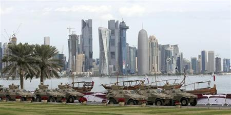 Members of the Qatari Armed Forces travel in armoured personnel carriers during National Day celebrations in Doha
