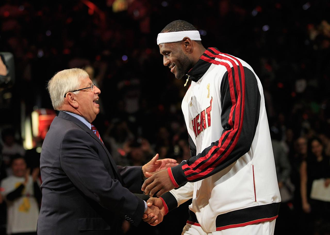 MIAMI, FL - OCTOBER 30: (L) NBA Commissioner David Stern greets  (R) LeBron James #6 of the Miami Heat as the Miami Heat are given their 2012 NBA Championship rings at a ceremony prior to the game against the Boston Celtics at American Airlines Arena on October 30, 2012 in Miami, Florida. NOTE TO USER: User expressly acknowledges and agrees that, by downloading and/or using this Photograph, user is consenting to the terms and conditions of the Getty Images License Agreement. (Photo by Chris Trotman/Getty Images)