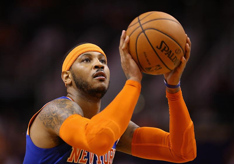 Carmelo Anthony of the New York Knicks shoots a free throw shot against the Phoenix Suns during the NBA game at US Airways Center on March 28, 2014 in Phoenix, Arizona