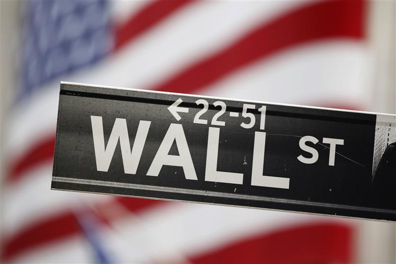 A street sign stands outside of the New York Stock Exchange