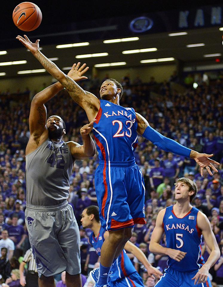 Kansas' Ben McLemore (23) pulls down a rebound in front of Kansas State's Thomas Gipson during the first half at Bramlage Coliseum on Tuesday, January 22, 2013, in Manhattan, Kansas. The visiting Jayhawks defeated K-State, 59-55. (Rich Sugg/Kansas City Star/MCT)