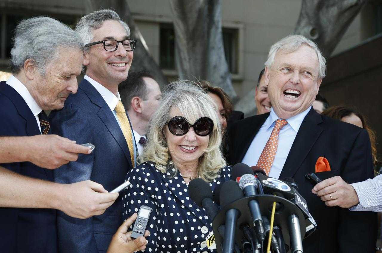 Shelly Sterling, 79, (2nd R) speaks at a news conference with her lawyer Pierce O'Donnell (R) and Steve Ballmer's lawyer Adam Streisand (2nd L) in Los Angeles, California July 28, 2014. The record $2 billion sale of pro basketball's Los Angeles Clippers to former Microsoft Corp chief executive Steve Ballmer can proceed over the objections of co-owner Donald Sterling, a judge tentatively ruled on Monday. Los Angeles Superior Court Judge Michael Levanas said the deal, brokered by Sterling's estranged wife, Shelly Sterling, was permissible and could be consummated even if Sterling, who has been banned for life from the NBA for racist remarks, chose to appeal. REUTERS/Lucy Nicholson (UNITED STATES - Tags: CRIME LAW SPORT BASKETBALL TPX IMAGES OF THE DAY)