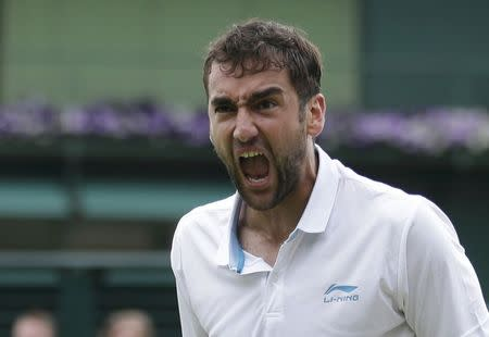 Marin Cilic of Croatia reacts after defeating Jeremy Chardy of France in their men's singles tennis match at the Wimbledon Tennis Championships, in London