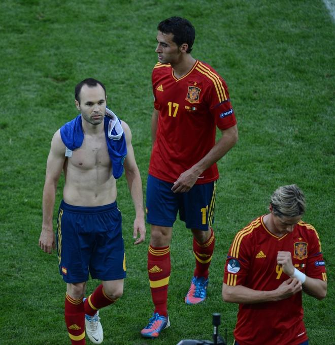 Spanish midfielder Andres Iniesta (L) reacts at the end of the Euro 2012 championships football match Spain vs Italy on June 10, 2012 at the Gdansk Arena.     AFPPHOTO/ PATRIK STOLLARZPATRIK STOLLARZ/AFP/GettyImages