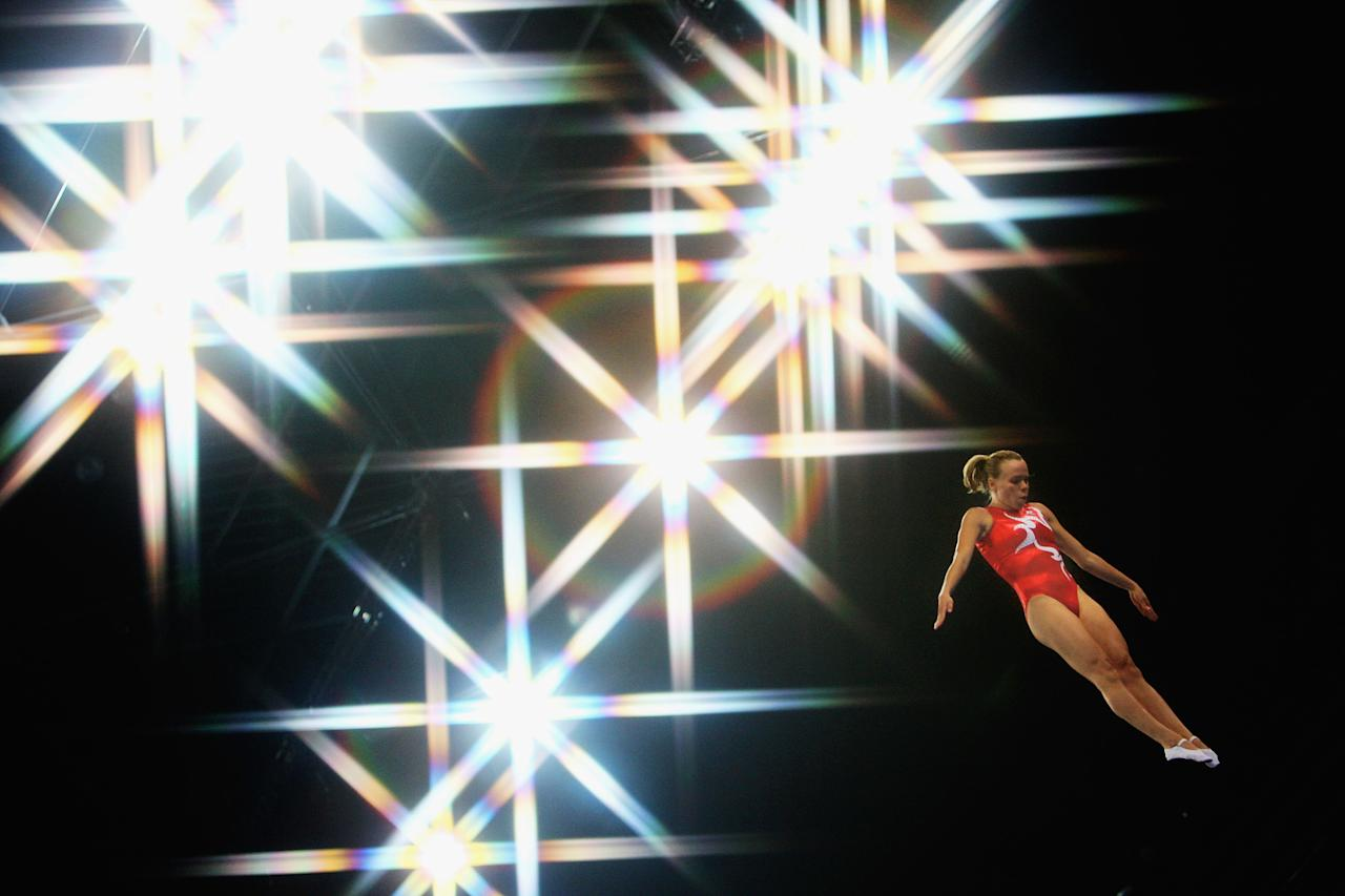 BEIJING - AUGUST 18:  (EDITORS NOTE: A special effects camera filter was used for this image.) Karen Cockburn of Canada competes in the trampoline women?s final gymnastics event at the National Indoor Stadium on Day 10 of the Beijing 2008 Olympic Games on August 18, 2008 in Beijing, China.  (Photo by Julian Finney/Getty Images)
