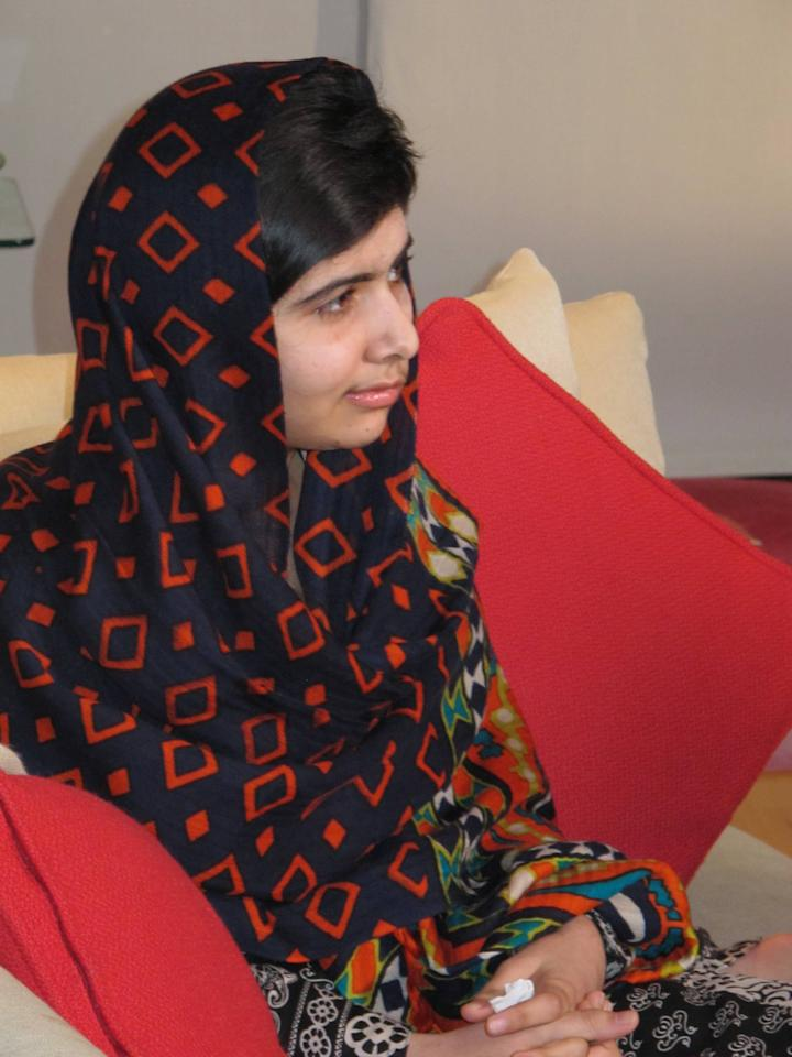 "In this Jan. 22 2013 photo released Monday Feb. 4 2013, fifteen-year-old Malala Yousefzai relaxes. The Pakistani girl shot by the Taliban on Oct. 9 2012 has made her first video statement since she was nearly killed, released Monday, saying she is recovering. Speaking clearly but with a slight stiffness in her upper lip, Malala said that she was ""getting better, day by day."" (AP Photo/Courtesy of Malala Yousefzai)"