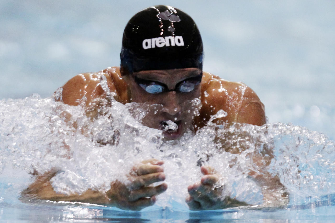 Clark Burckle swims the men's 200-meter breaststroke at the Indianapolis Grand Prix swimming meet in Indianapolis, Thursday, March 29, 2012. (AP Photo/Michael Conroy)