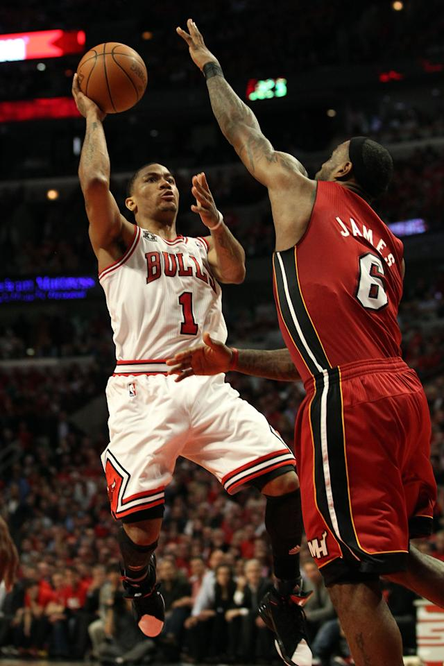 CHICAGO, IL - MAY 26:  Derrick Rose #1 of the Chicago Bulls drives for a shot attempt against LeBron James #6 of the Miami Heat in Game Five of the Eastern Conference Finals during the 2011 NBA Playoffs on May 26, 2011 at the United Center in Chicago, Illinois. NOTE TO USER: User expressly acknowledges and agrees that, by downloading and or using this photograph, User is consenting to the terms and conditions of the Getty Images License Agreement.  (Photo by Jonathan Daniel/Getty Images)