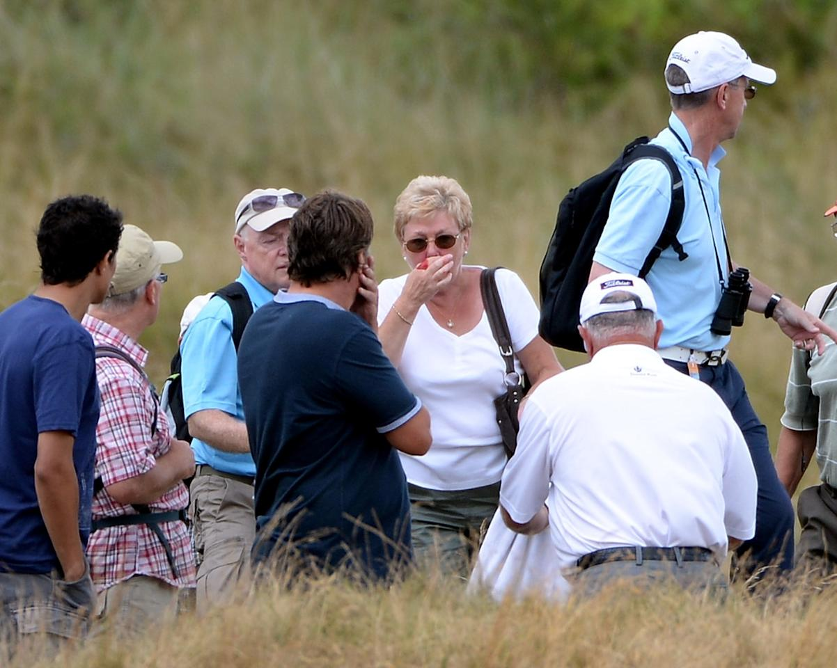 SOUTHPORT, ENGLAND - JULY 25: Mark O'Mera of the USA goes to the aid of a golf fan who was hit by his errant shot during the first round of The Senior Open Championship at Royal Birkdale on July 25, 2013 in Southport, England. (Photo by Ross Kinnaird/Getty Images)