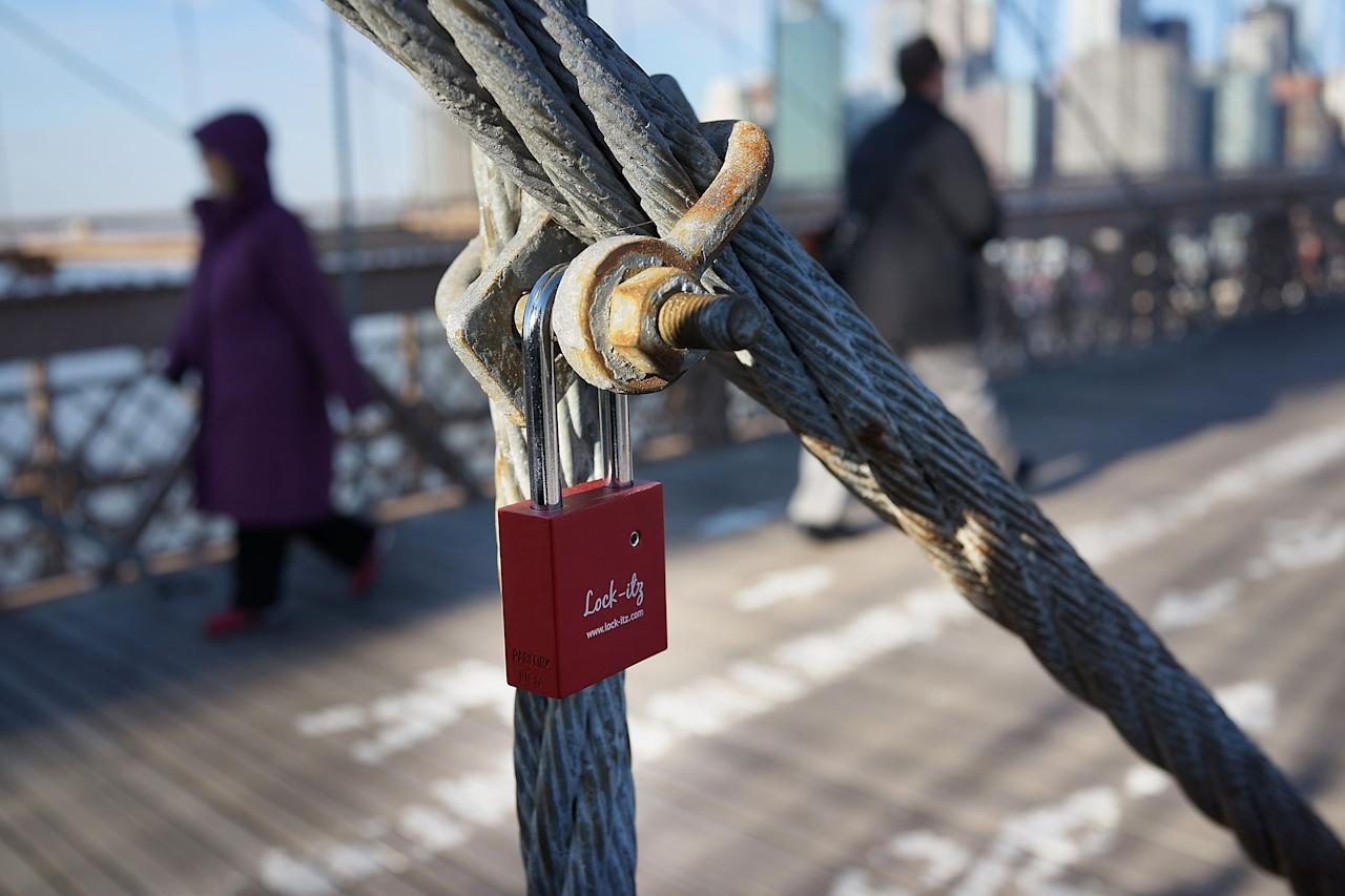 "NEW YORK, NY - FEBRUARY 13:  A ""love lock"" is viewed on the Brooklyn Bridge, one of thousands that have been placed along the bridge recently on February 13, 2013 in New York City. The phenomenon has gained followers in recent years as couples seek to publicly mark weddings, engagements, and anniversaries in a permanent way. Besides New York, ""love locks"" can be found on public monuments and bridges in Venice, St. Petersburg and Paris amongst other cities.  (Photo by Spencer Platt/Getty Images)"