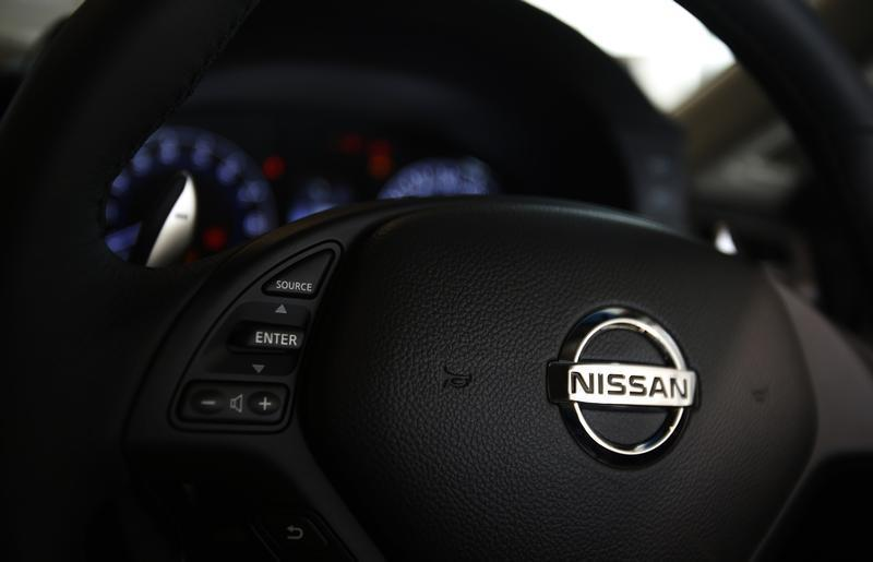 A logo of Nissan Motor Co is seen on a steering wheel of a car at the company's showroom in Yokohama