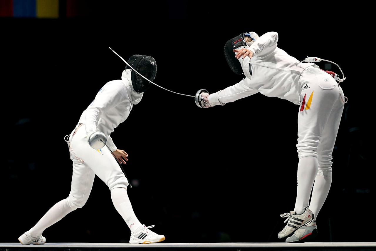 LONDON, ENGLAND - JULY 30:  Britta Heidemann (R) of Germany competes against Yana Shemyakina (L) of Ukraine during the Gold medal bout in the Women's Epee Individual Fencing Finals on Day 3 of the London 2012 Olympic Games at ExCeL on July 30, 2012 in London, England.  (Photo by Ezra Shaw/Getty Images)