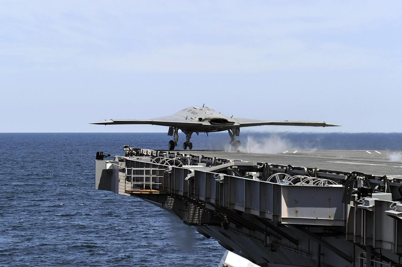ATLANTIC OCEAN - MAY 14:  In this handout released by the U.S. Navy courtesy of Northrop Grumman, an X-47B Unmanned Combat Air System (UCAS) demonstrator launches from the aircraft carrier USS George H.W. Bush (CVN 77) May 14, 2013 in the Atlantic Ocean. George H.W. Bush is the first aircraft carrier to successfully catapult-launch an unmanned aircraft from its flight deck. The Navy plans to have unmanned aircraft on each of its carriers to be used for surveillance and be armed and used in combat roles.  (Photo by Alan Radecki/U.S. Navy/Northrop Grumman via Getty Images)