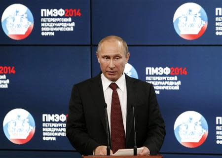 Russia's President Putin speaks during a session of the St. Petersburg International Economic Forum 2014 in St. Petersburg