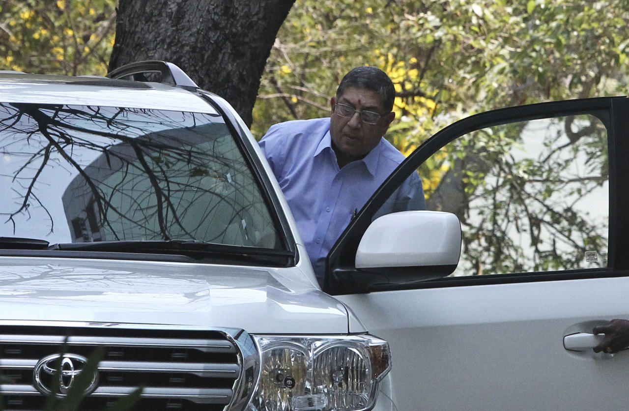 Indian cricket board chief Narayanaswami Srinivasan gets into his car at the premises of the corporate office of India Cements, a company headed by him in Chennai, India, Tuesday, March 25, 2014. The Supreme Court of India has told Srinivasan to step down from his post or be forced to leave to ensure a fair investigation into charges of match-fixing in the Indian Premier League. (AP Photo/Arun Sankar K)