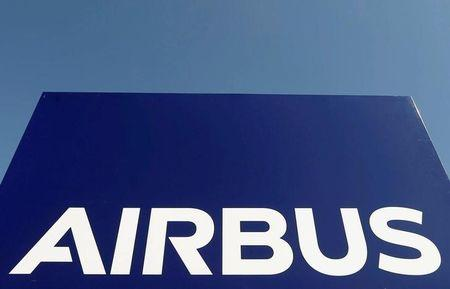 Airbus wrestles with problem planes as profit halves