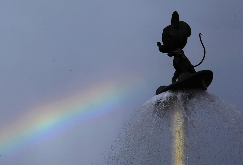 Rainbow is seen behind a fountain featuring Mickey Mouse at entrance of Hong Kong Disneyland