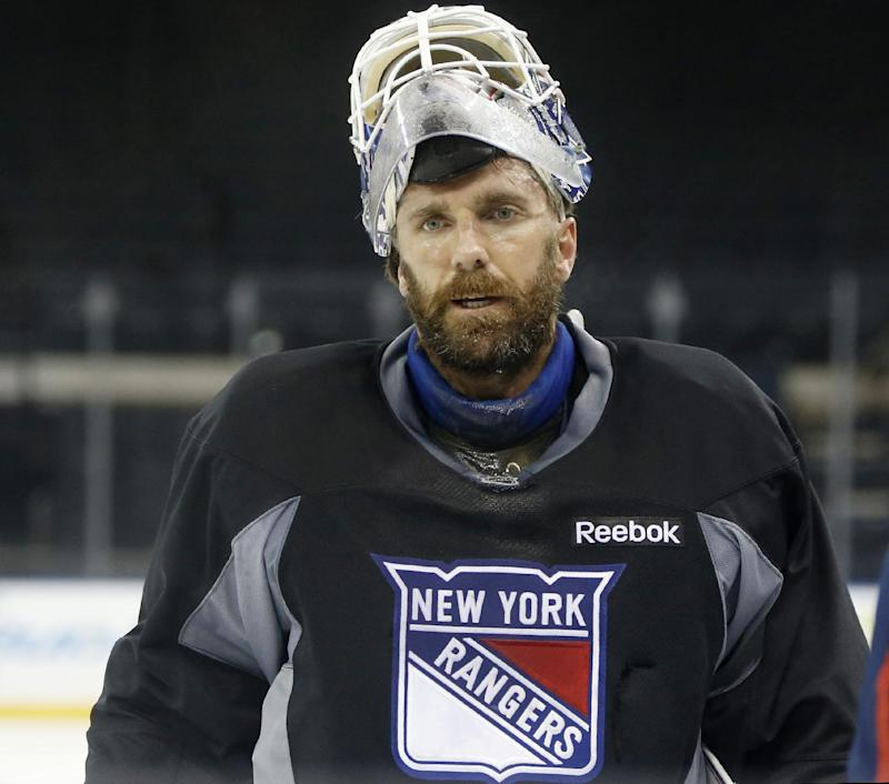 New York Rangers goalie Henrik Lundqvist of Sweden leaves the ice after participating in an optional practice for Game 4 of the Stanley Cup Finals at Madison Square Garden in New York, Tuesday, June 10, 2014. The Los Angeles Kings have a 3-0 lead over the Rangers in the best-of-seven series