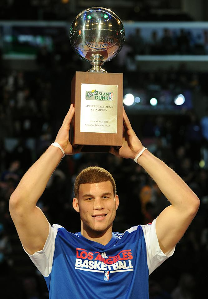 Blake Griffin from L.A. Clippers celebrates after winning the All-Stars Slam Dunk contest at the Staples Center in Los Angeles on February 19, 2011.  The event took place ahead of Sunday's 60th NBA All-Star Game showdown between Eastern and Western conference superstars at Los Angeles on February 20.        AFP PHOTO/Mark RALSTON (Photo credit should read MARK RALSTON/AFP/Getty Images)