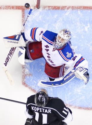 Rangers goalie Henrik Lundqvist and Kings center Anze Kopitar watch the puck during Game 1 in Los Angeles. (AP)