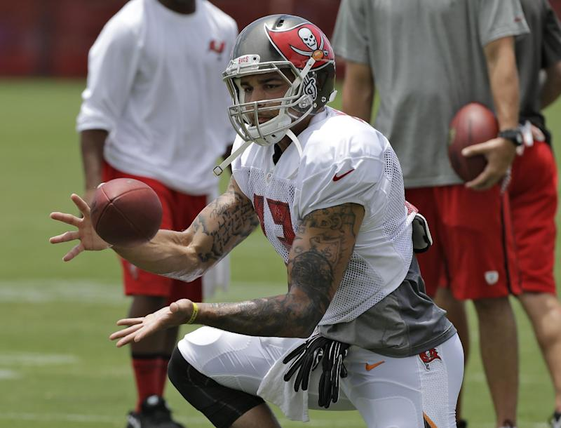 Tampa Bay Buccaneers first-round pick Mike Evans catches the football during an NFL football training camp Monday, July 28, 2014, in Tampa, Fla