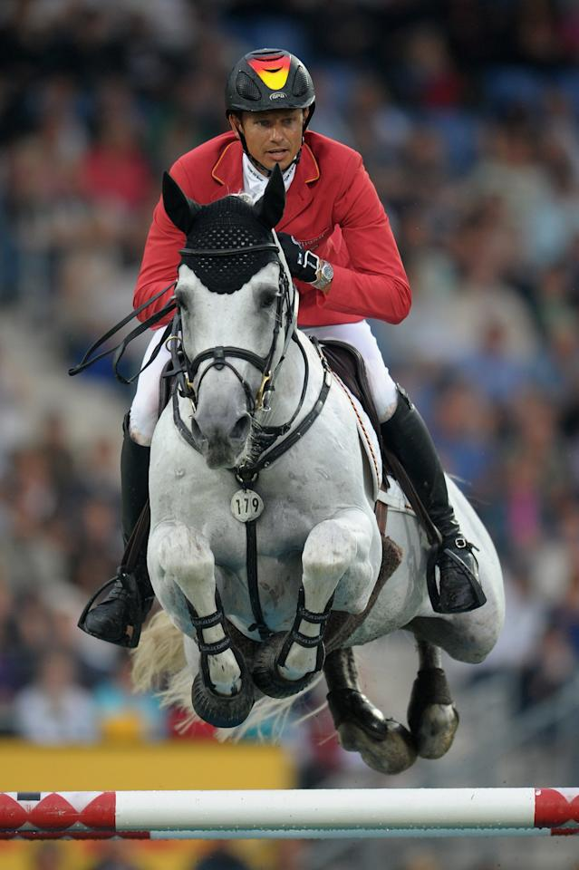 AACHEN, GERMANY - JULY 05:  Marco Kutscher of Germany and his horse Cornet Obolensky compete in the Mercedes-Benz Price team jumping competition during day three of the 2012 CHIO Aachen tournament on July 5, 2012 in Aachen, Germany.  (Photo by Dennis Grombkowski/Bongarts/Getty Images)