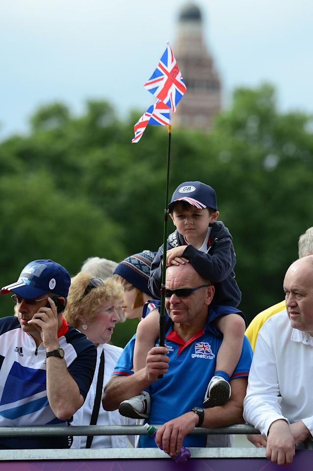 LONDON, ENGLAND - JULY 28: British cycling fans wait for cyclists during the Men's Road Race Road Cycling on day 1 of the London 2012 Olympic Games on July 28, 2012 in London, England.  (Photo by Jamie Squire/Getty Images)