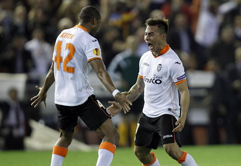 Valencia's  Eduardo Vargas from Chile, right , celebrates with teammate Seydou Keita, left, after scoring against Basel, during the Europa League quarterfinal, second leg soccer match at the Mestalla stadium in Valencia, Spain, Thursday, April 10, 2014