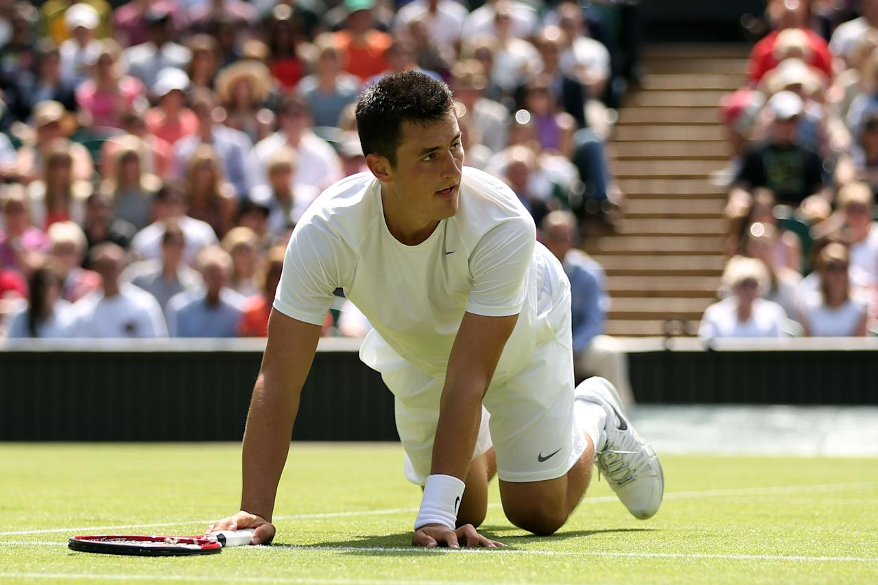 LONDON, ENGLAND - JUNE 29: Bernard Tomic of Australia looks up after diving for a shot during the Gentlemen's Singles third round match against Richard Gasquet of France on day six of the Wimbledon Lawn Tennis Championships at the All England Lawn Tennis and Croquet Club on June 29, 2013 in London, England. (Photo by Clive Brunskill/Getty Images)