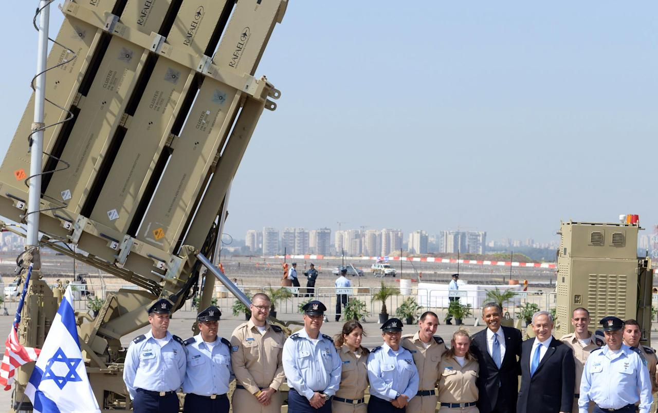 TEL AVIV, ISRAEL - MARCH 20:  (ISRAEL OUT) In this handout image supplied by the Government Press Office of Israel (GPO), US President Barack Obama (7th R) and Israeli President Benjamin Nethanyahu pose with members of the military in front of a missile launcher, at Ben Gurion International Airport on March 20, 2013 near Tel Aviv, Israel.  This will be Obama's first visit as President to the region, and his itinerary will include meetings with the Palestinian and Israeli leaders as well as a visit to the Church of the Nativity in Bethlehem. (Photo by Moshe Milner/GPO via Getty Iimages)