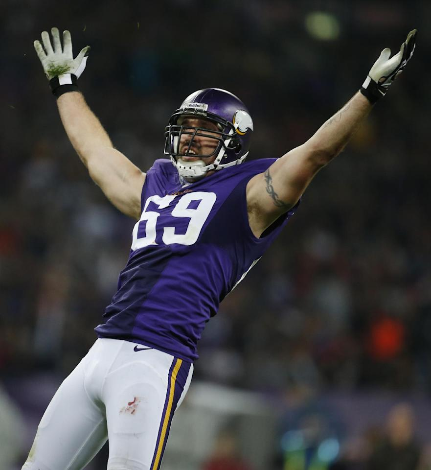 FILE - In this Sept. 29, 2013, file photo, Minnesota Vikings defensive end Jared Allen celebrates after sacking Pittsburgh Steelers quarterback Ben Roethlisberger during the first half of an NFL football game at Wembley Stadium in London. The Chicago Bears replaced one accomplished veteran pass rusher with another Wednesday, March 26, 2014, when they agreed to terms with Allen on a four-year contract. A person with knowledge of the agreement told The Associated Press that Allen will get $15.5 million guaranteed on a deal that could be worth as much as $32 million. The person requested anonymity because the terms have not been announced. (AP Photo/Matt Dunham, File)