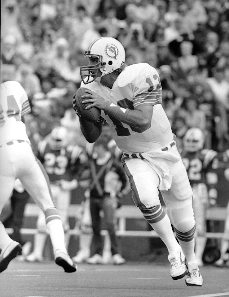 FILE - This Oct. 21, 1984 fiile phoro shows Miami Dolphins quarterback Dan Marino looking for an open receiver during second quarter NFL action against the New England Patriots, in Foxboro, Mass. Marino figures his NFL passing yardage record is doomed to fall soon. He set the record of 5,084 yards in 1984, and frankly, he's surprised it still stands. (AP Photo/David Tenenbaum, File)