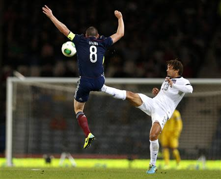 Scotland's Brown is tackled by Jones of the U.S. during their international friendly soccer match in Glasgow