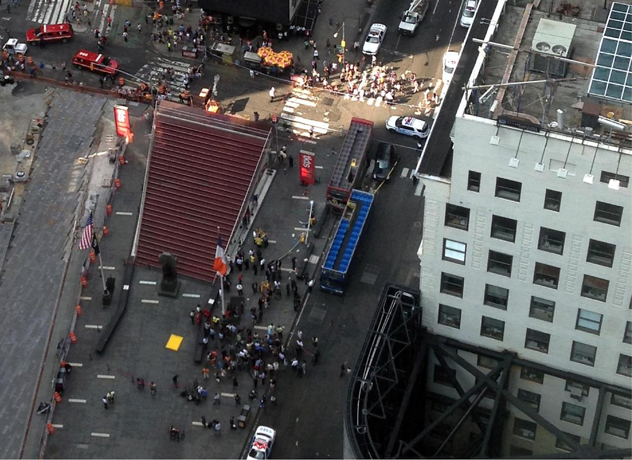 In this photo emergency personnel respond to a bus crash on Tuesday, Aug. 5, 2014, in New York City's Times Square. The accident occurred around 47th Street and Seventh Avenue in Manhattan. (AP Photo)
