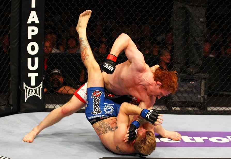 ATLANTA, GA - APRIL 21:  Mark Bocek (top) punches John Alessio during their lightweight bout for UFC 145 at Philips Arena on April 21, 2012 in Atlanta, Georgia.