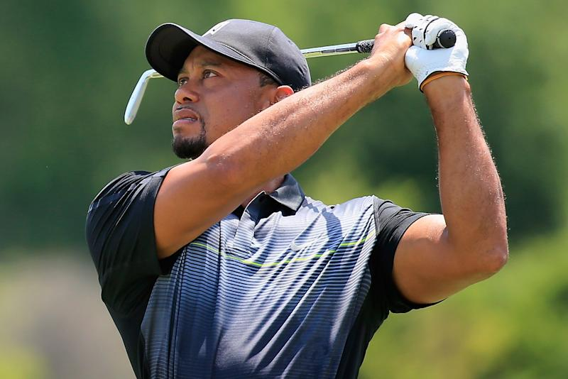 Tiger Woods hits balls on the range in preparation for the Quicken Loans National golf tournament at Congressional Country Club on June 24, 2014 in Bethesda, Maryland