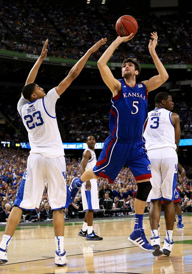 Jeff Withey #5 of the Kansas Jayhawks shoots over Anthony Davis #23 of the Kentucky Wildcats in the second half in the National Championship Game of the 2012 NCAA Division I Men's Basketball Tournament at the Mercedes-Benz Superdome on April 2, 2012 in New Orleans, Louisiana. (Photo by Ronald Martinez/Getty Images)