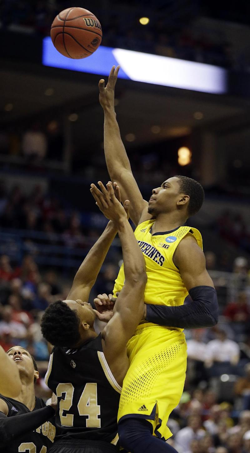 Michigan holds off pesky Wofford 57-40