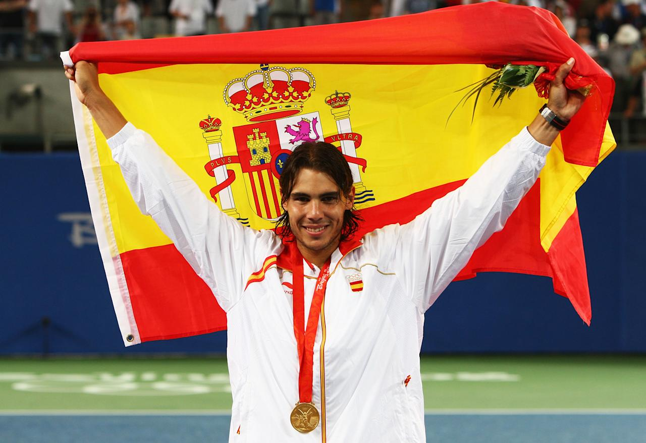 Rafael Nadal of Spain celebrates winning the gold medal against Fernando Gonzalez of Chile during the men's singles gold medal tennis match held at the Olympic Green Tennis Center during Day 9 of the Beijing 2008 Olympic Games on August 17, 2008 in Beijing, China.