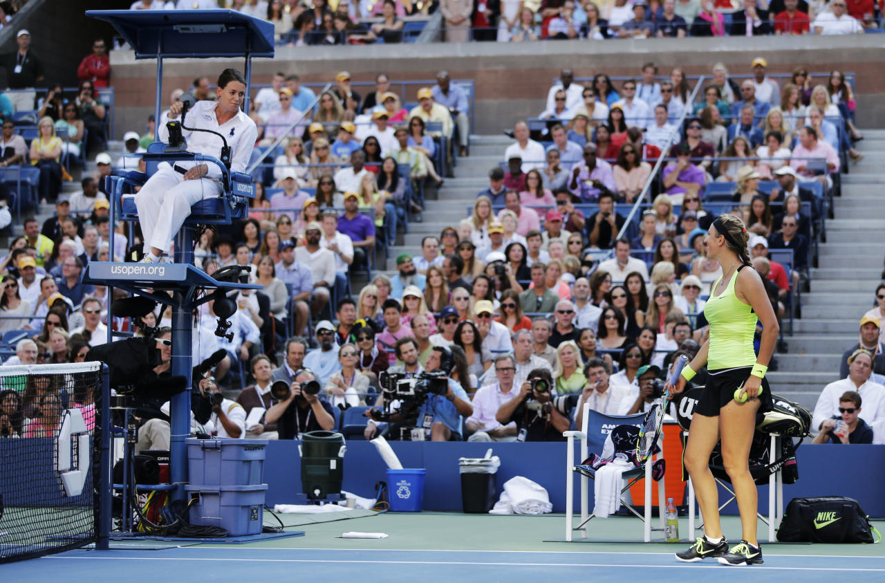 Victoria Azarenka of Belarus, right, argues with the chair umpire during the championship match against Serena Williams at the 2012 US Open tennis tournament, Sunday, Sept. 9, 2012, in New York. (AP Photo/Mike Groll)